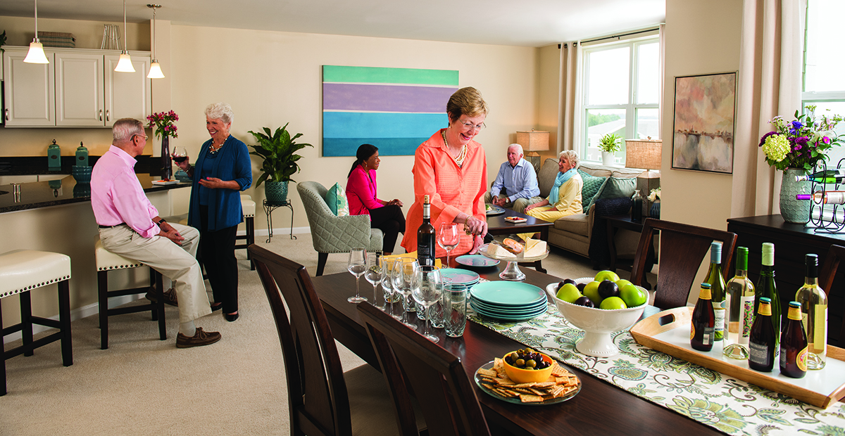 Residents enjoy a party in a spacious apartment